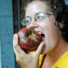 Debbie samples a Cherokee Purple tomato.