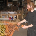 Weaving a hammock: a Twin Oaks member weaving a hammock